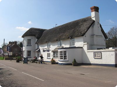 Picture of Blue ball Inn. Daytime, Thatched building.