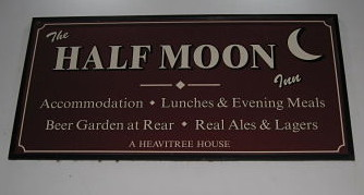 Half Moon pub sign.